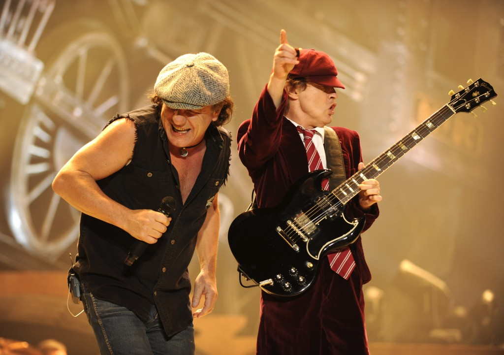 """WILKES-BARRE, PN - OCTOBER 28:  Malcolm Young (L) and Angus Young of AC/DC perform during their """"Black Ice"""" Tour Opener on October 28, 2008 in Wilkes-Barre, Pennsylvania.  (Photo by Kevin Mazur/Getty Images)"""