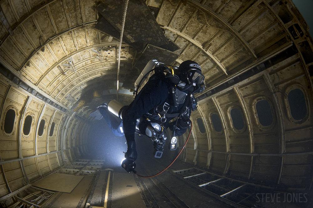 bae-146-plane-wreck-diver-underwater